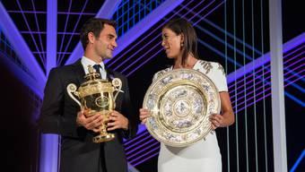 Die Wimbledon-Champions: Roger Federer zusammen mit Garbine Muguruza.
