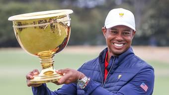 Captain und Spieler Tiger Woods strahlt nach dem Gewinn des Presindents Cup