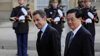 Sarkozy erwidert das chinesische Lächeln