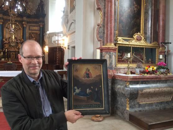 Dr. L. Hüsser in der Kirche St. Niklaus, Herznach