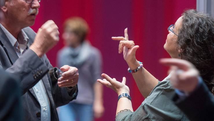 Gehörlose Menschen haben es in der Berufswelt oft schwer. (Symbolbild)