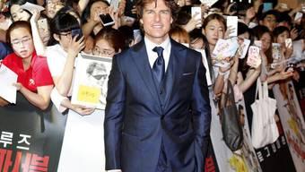 Tom Cruise am Donnerstag in Seoul. Derweil lässt eine kontroverse Kunstinstallation das Internet über die Grösse seiner Kronjuwelen rätseln.