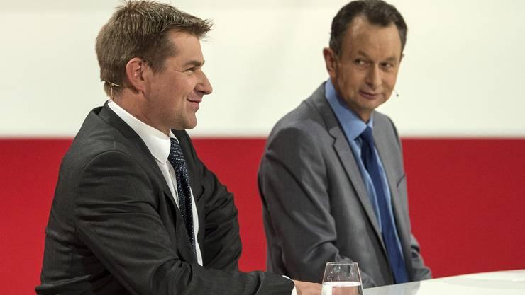 SVP-Präsident Toni Brunner (links) mit seinem FDP-Amtskollegen Philipp Müller. (Archiv)