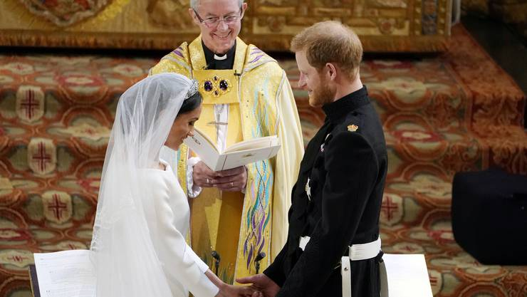 Britain's Prince Harry and Meghan Markle exchange vows during their wedding ceremony at St. George's Chapel in Windsor Castle in Windsor, near London, England, Saturday, May 19, 2018. (Owen Humphreys/pool photo via AP)