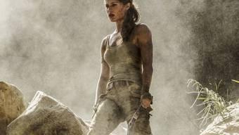 """Alicia Vikander spielt Lara Croft in der Neuauflage von """"Tomb Raider"""". Die Computerspiel-Verfilmung setzte sich am Wochenende vom 15. bis 18. März 2018 an die Spitze der CH-Kinocharts. (Archiv)"""