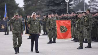 epa07228847 President of the Republic of Kosovo Hashim Thaci (C) inspects Members of the Kosovo Security Force (KSF) in Pristina, Kosovo, 13 December 2018. The 120 seat parliament of the Republic of Kosovo is expected to vote for the laws to transform the Security Forces into an official army during the plenary session on 14 December. Parliament in Kosovo, which relies on NATO troops for its protection, voted on 18 October 2018 to set up a 5,000-strong national army though its Serb minority said the move was illegal. EPA/STRINGER