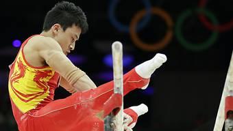 Feng Zhe liess am Barren die Konkurrenz hinter sich