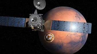 """Dieses von der ESA publizierte Bild stellt die Abkopplung des Landegeräts von der Atmosphärensonde dar. Am Mittwoch soll """"Schiaparelli"""" auf dem Roten Planeten aufsetzen."""