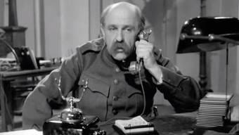 HD-Soldat Läppli am Telefon im Kompaniebüro Pruntrut.