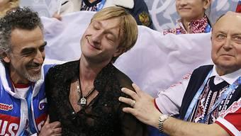 Jewgeni Pluschenko lässt sich nach seiner Kür feiern