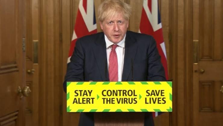 Boris Johnson, Premierminister von Großbritannien, spricht bei einer Pressekonferenz zum Thema Coronavirus in der 10 Downing Street.) Foto: Pa Video/PA Wire/dpa