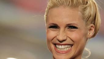 Michelle Hunziker hat gut Lachen: Die schöne Blondine hat ihr Herz an eine Pudeldame verloren (Archiv)