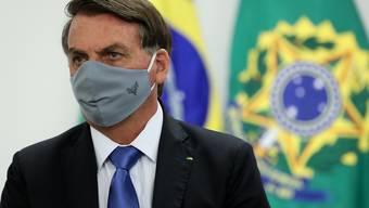 HANDOUT - Der brasilianische Präsident Jair Bolsonaro hat sich mit dem Coronavirus infiziert. Foto: Marcos Correa/Palacio Planalto/dpa - ACHTUNG: Nur zur redaktionellen Verwendung und nur mit vollständiger Nennung des vorstehenden Credits