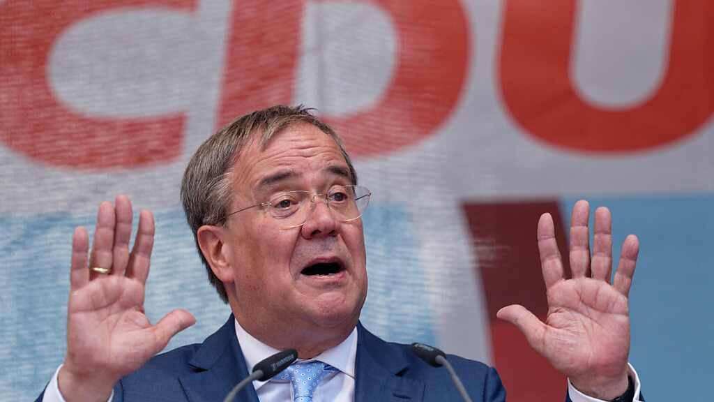 Laschet erwartet «sehr knappes Rennen» - Scholz verspricht Wohnungen