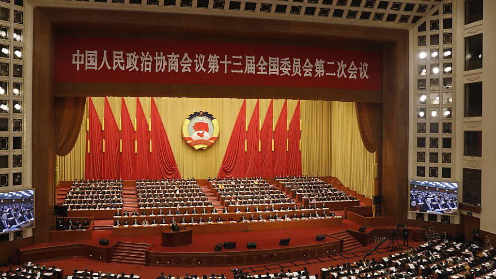 Die Delegierten warten auf die Eröffnung der Jahrestagung des chinesischen Volkskongresses. Während der Sitzung wird es auch um die Verteidigungsausgaben gehen.