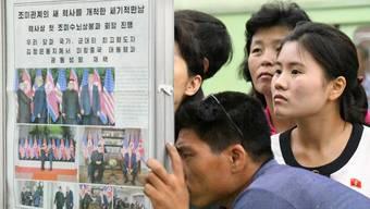 An einer Bahnstation in Pjöngjang blicken Passanten gebannt auf die örtliche Zeitung. Was hat der Gipfel gebracht?