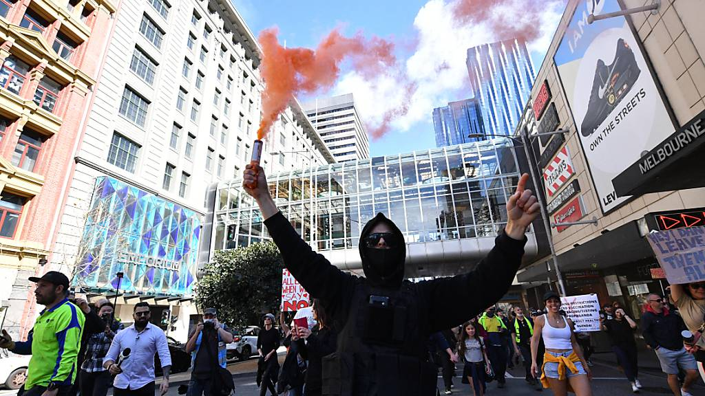 Protesters are seen during an anti-lockdown protest in the central business district of Melbourne, Saturday, August 21, 2021. (AAP Image/James Ross) NO ARCHIVING