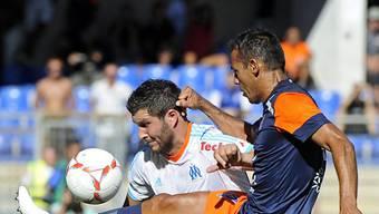 Montpelliers Hilton (r.) gegen Torschütze André-Pierre Gignac