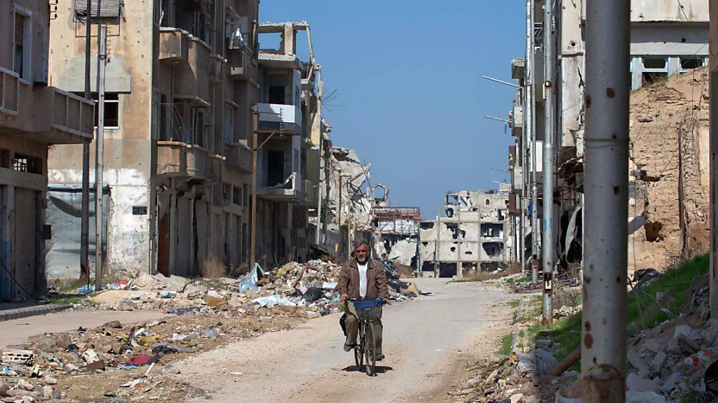Für viele syrische Städte kommen Friedensverhandlungen zu spät - wie für die westsyrische Grossstadt Homs, wo das Zentrum vollkommen zerstört ist (Aufnahme vom 26. Februar dieses Jahres).