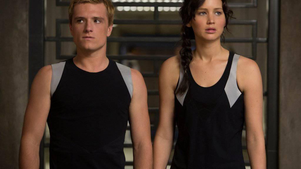 Jennifer Lawrence und Josh Hutcherson - hier in «The Hunger Games: Catching Fire» - sind äusserst skeptisch über die Echtheit von Donald Trumps Präsidentschafts-Kandidatur (Archiv).