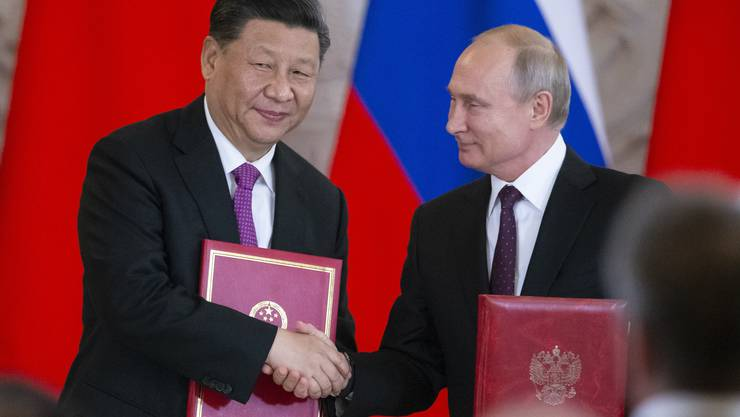Chinas Präsident Xi Jinping (l.) zu Gast bei Wladimir Putin.