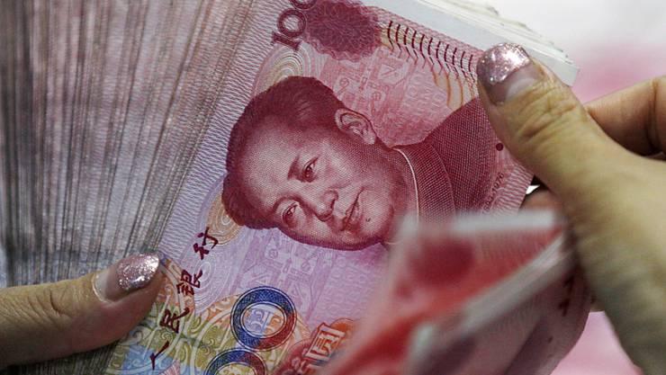 Chinas Nationalbank hat bereits den Yuan abgewertet, um Exporte zu fördern. Der Staat plant weitere Massnahmen zur Stützung der Konjunktur.