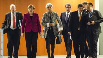 Bundeskanzlerin Merkel mit IWF-Chefin Lagarde (Mitte) in Berlin