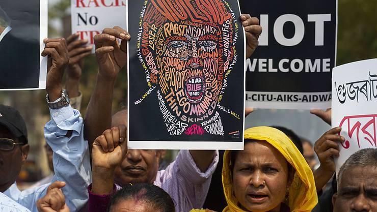Indische Aktivisten lehnten Trumps Besuch ab.