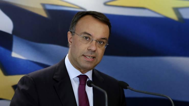 Der neue griechische Finanzminister Christos Staikouras und seine Regierungskollegen sind vereidigt worden. (Archiv)