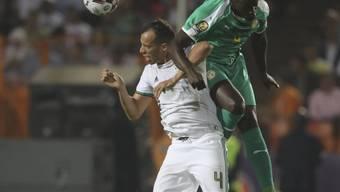 Harte Zweikämpfe mit dem besseren Ende für Algerien: Mit einem 1:0-Sieg gegen Senegal wurden die Wüstenfüchse zum zweiten Mal Afrika-Meister