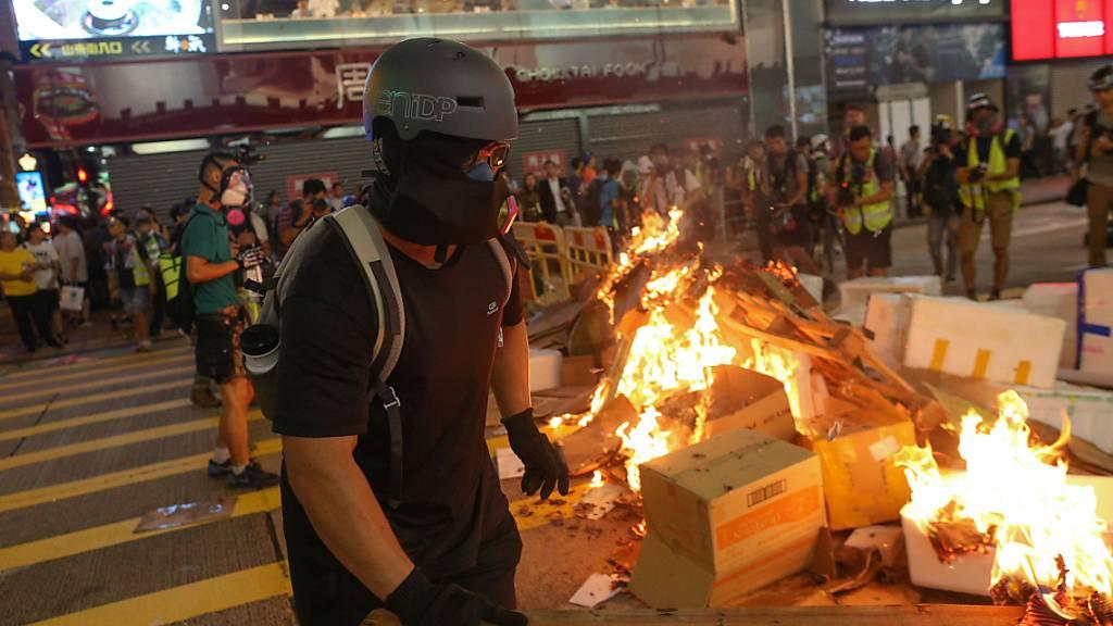 Proteste in Hongkong dauern während Merkels China-Besuch an