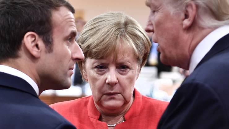 Der französische Präsident Emmanuel Macron trifft am Donnerstag erst die deutsche Bundeskanzlerin Angela Merkel und dann den US-Präsidenten Donald Trump. (Archivbild)